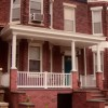 All new porch, stoop and awning plus refurbished cornice and repointed brick facade